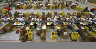 Workers sort packages at the Amazon warehouse in Leipzig